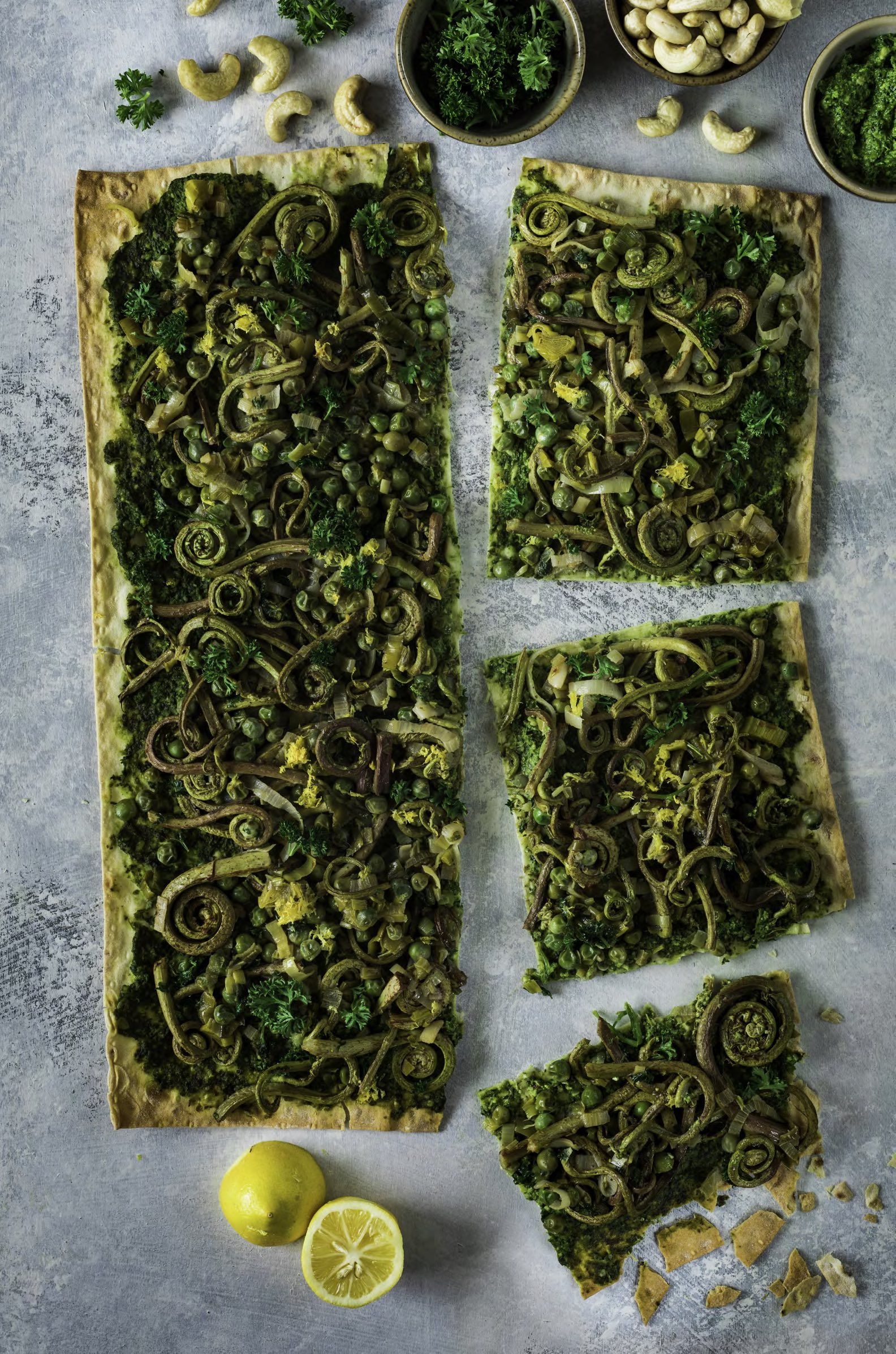 FLATBREAD WITH KALE PESTO, GREEN PEAS, AND FIDDLEHEADS Enchanted Living Magazine Recipe