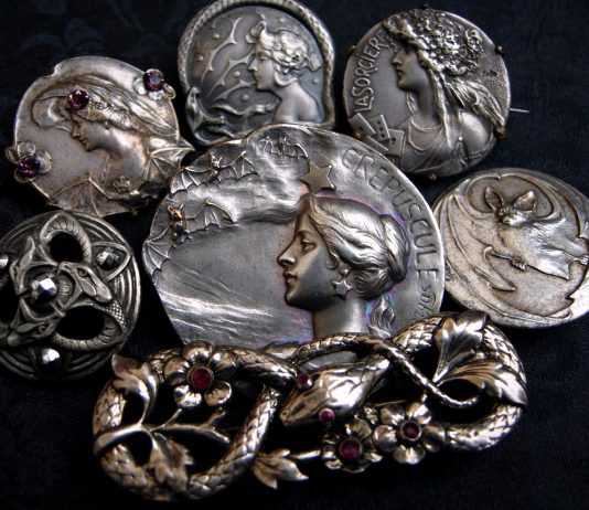 Serpents and Sorceresses—a decadent assortment of antique Art Nouveau brooches and buttons, including interlaced serpents accented with shimmering garnets and marcasite, a fluttering of bats, plus the witchy women who are perfectly content to share their time with either (and perhaps be convinced to tell your fortune while doing so).