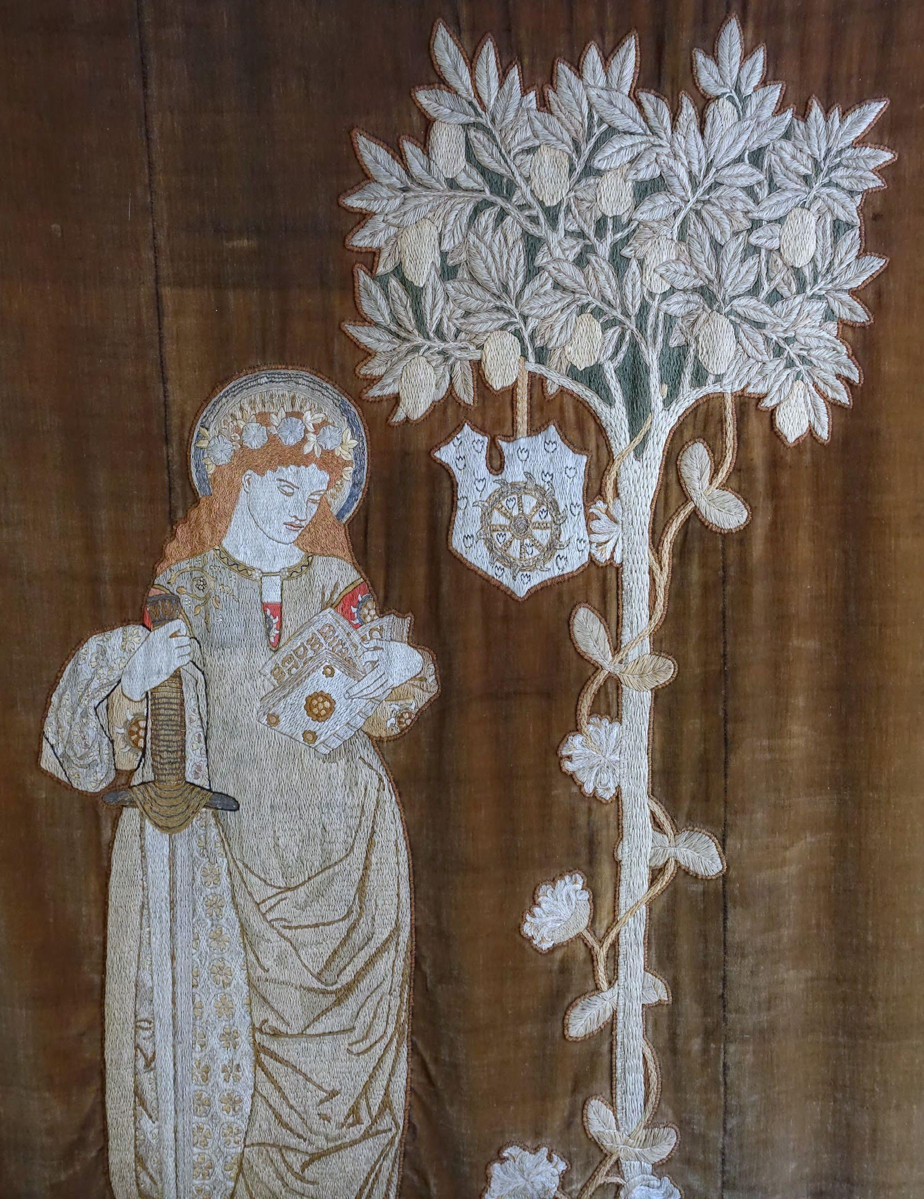 St. Catherine wall hanging, designed by William Morris, worked by Jane Morris, 1860-1861. Wikimedia Commons.