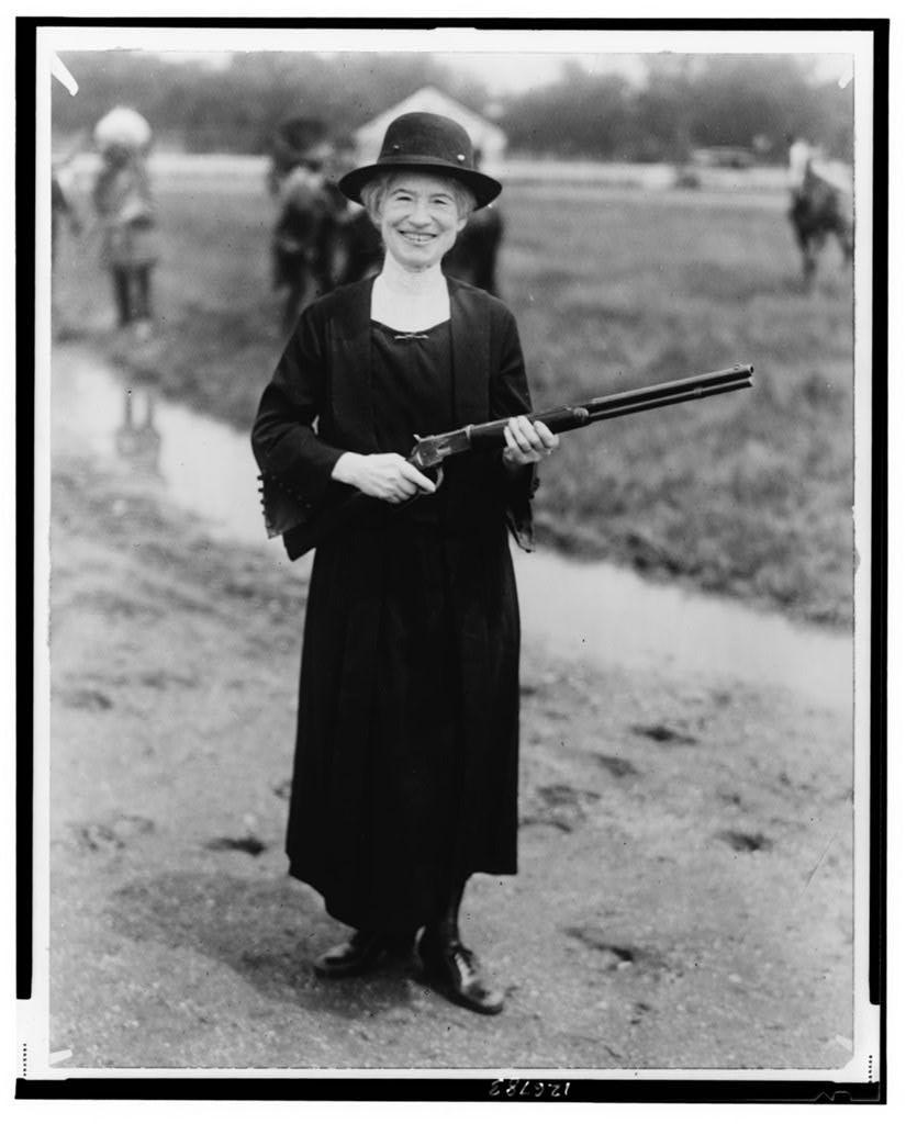 Annie Oakley, with gun Buffalo Bill gave her / staff photo.